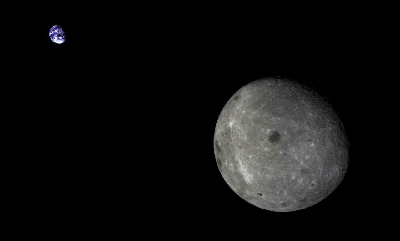 The far side of the Moon and the distant Earth, imaged by the Chang'e-5T1 mission in 2014.